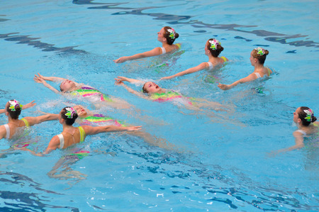 Warsaw, Poland - June 12, 2011: A display team synchronized swimming in the pool during competition at the University of Physical Education.