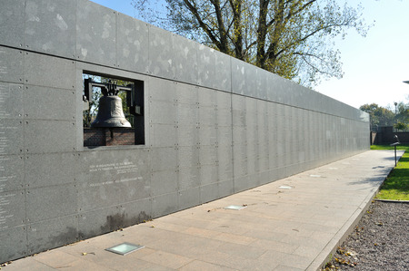 an obeisance: Warsaw, Poland - October 7, 2010: Memorial Wall with the names of thousands of Insurgents who died in the Uprising, from 1 August to 2 October 1944 - The Warsaw Uprising Museum.