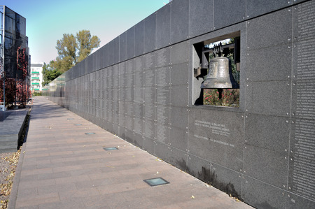 Warsaw, Poland - October 7, 2010: Memorial Wall with the names of thousands of Insurgents who died in the Uprising, from 1 August to 2 October 1944 - The Warsaw Uprising Museum.