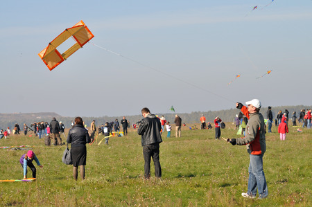 flying kites: WARSAW, POLAND - OCTOBER 10, 2010: contestants and flying kites during the Warsaw Championships Youngsters in competition kites.