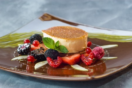 Creme Catalan And A Selection Of Summer Fruits Stock Photo