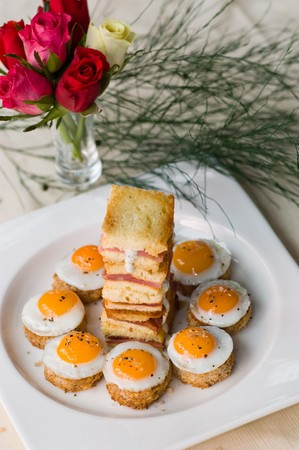 A Starter Of Mini Fried Quail Eggs And Sweet Back Bacon Sandwiches