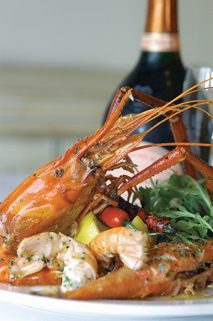 Vietnamese giant freshwater prawn served with lemon salad and champagne