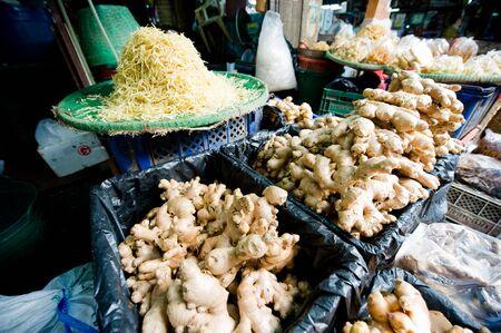 Whole and shredded fresh ginger at Pak Klong Market, Bangkok Stock Photo