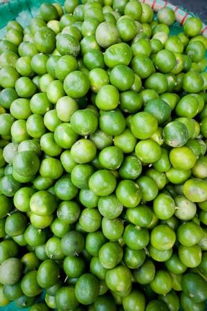 Close up of a bowl of Limes on display at Pak Klong Market, Bangkok Stock Photo