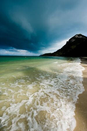 Tropical storm over a deserted beach Stock Photo