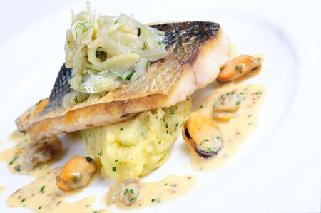 Pan-fried wild sea bass with fennel and herbs Stock Photo