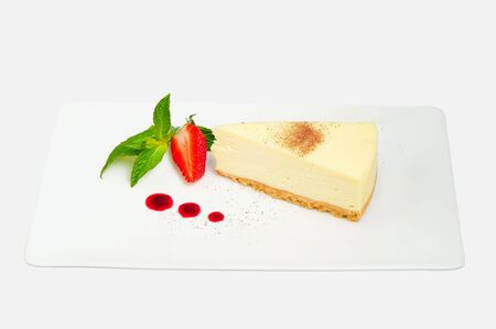 White chocolate cheesecake with strawberry coulis