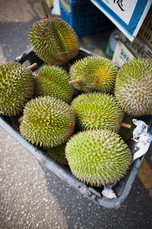 Ripe durians unpacked at a local market stall.