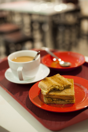 A close-up view of a morning breakfast set in a cafe.