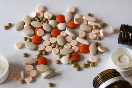 Different types of pills out of bottles 免版税图像