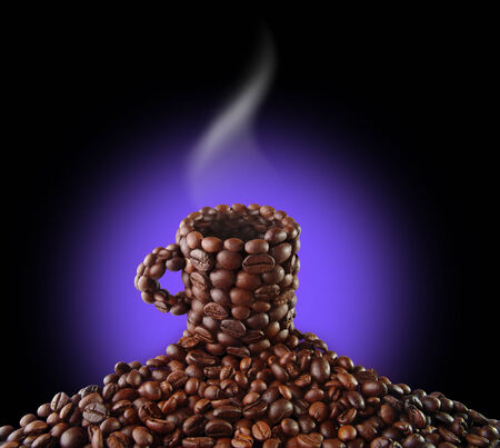 Cup from coffee grains Фото со стока