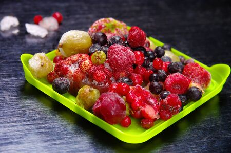 frozen fruit: Frozen fruit on a wooden surface Stock Photo