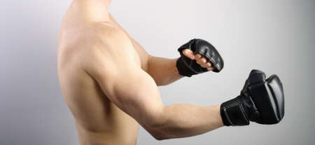 ultimate: Ultimate fight. Fighter with boxing gloves Stock Photo