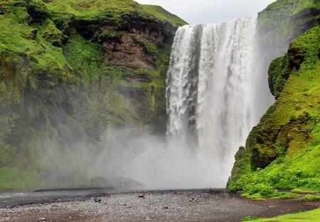 seson: Skogarfoss waterfall. Summer seson. Iceland. Stock Photo