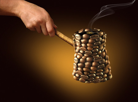 with coffee maker: Coffee maker consists of coffee beans on a golden-dark background Stock Photo
