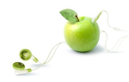 ヘッドフォンでリンゴの形をした音楽プレーヤー。音楽や果物の主題によるファンタジー。 写真素材