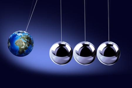 pendulum: The pendulum of Newton as the Earth symbolizing the risk, dynamics, fragility, etc. On the dark backgroundThe pendulum of Newton as the Earth symbolizing the risk, dynamics, fragility, etc. On the dark background Stock Photo