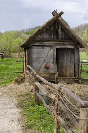 Old wooden barn with paddock. Stock Photo - 13284759