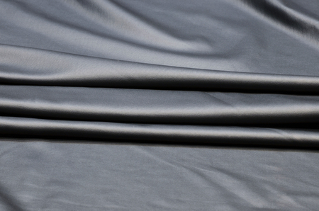 Polyamide elastane fabric in black color. Knitwear under the skin.