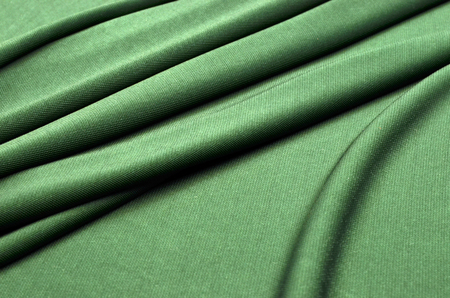 Knitwear of green color from viscose and elastane