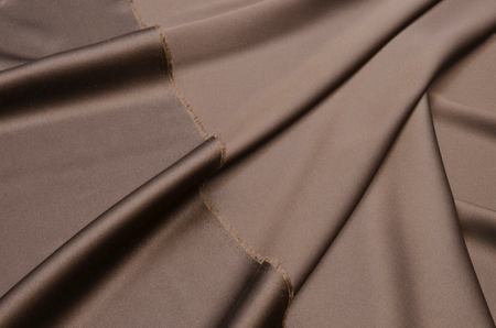 cotton fabric is dark brown with the addition of elastane.