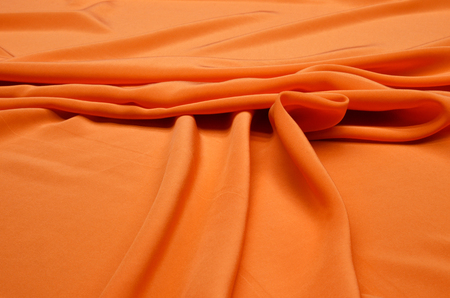 Silk fabrics of crepe de Chine orange