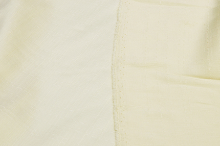 Textured silk of ivory color.