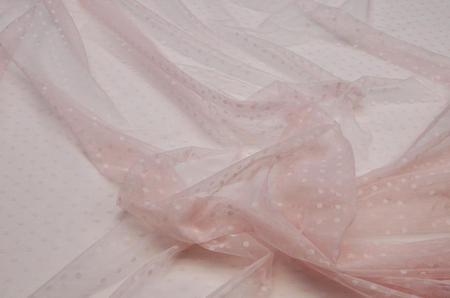 Polyamide fabric with polka dots light pink with elastane. 版權商用圖片