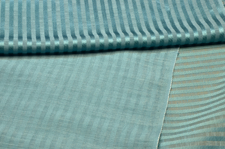 Fabric of silk and turquoise viscose.
