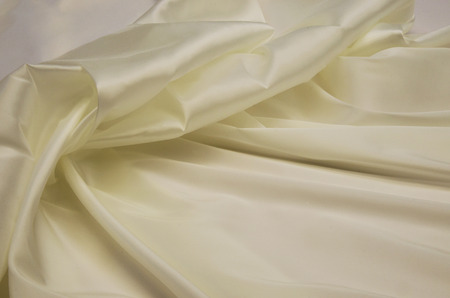 Lining fabric made of acetate and elastan in the color of ivory