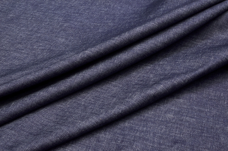 Denim fabric dark blue, melange, dense.