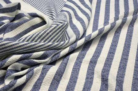 Jacquard with lurex in blue and white stripes