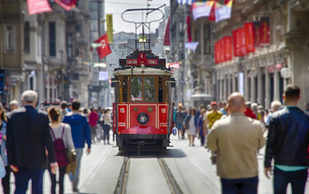 The old tram and people walking in Taksim in HDR