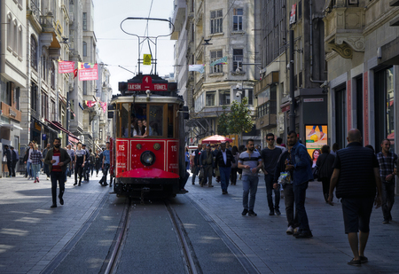 ISTANBUL, TURKEY - MAY 02, 2018: the old tram and people walking in Taksim on May 02, 2018 on Istanbul, Turkey