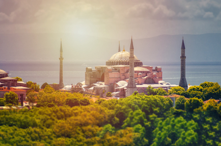 Hagia Sophia domes and minarets in the old town of Istanbul, Turkey, on sunset Stock Photo