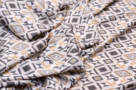 Cotton fabric with viscose, gray-beige geometric ornament on white Stockfoto