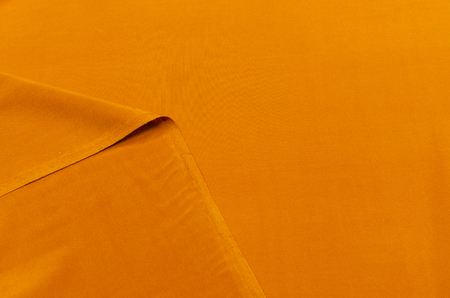 Silk fabric, crepe de Chine dark ocher Stockfoto
