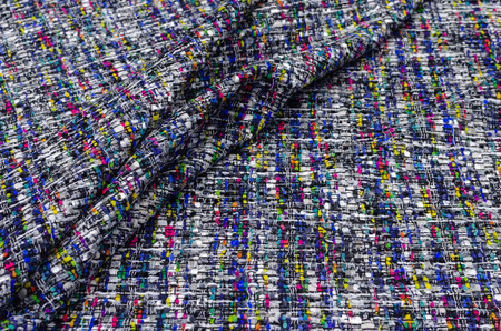 Tweed fabric with bright patches on black and white