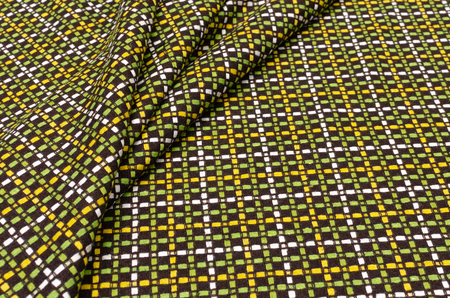 Fabric chanel in a yellow-white-green cage made of wool and polyamide Stock Photo