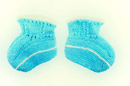 Knitted woolen socks of blue color for baby isolated on white background
