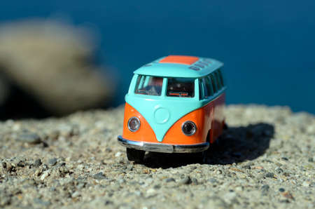 Vintage miniature orange and blue van. Travel concept