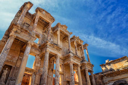 The front facade and courtyard of the Library of Celsus at Ephesus is an ancient Greek and Roman structure. Reconstructed by archaeologists from old stones, it is near the city of Izmir in Turkey.