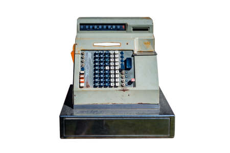 Old cash register with buttons and display on background.