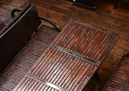 garden table: Wet garden table with chairs after the rain