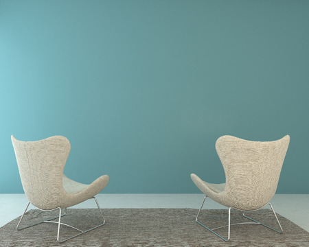 blue wall: Two chairs stand against the wall Stock Photo
