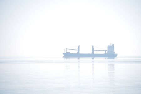 Abstract art ship composition in the ocean with fog