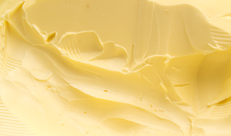 Closeup of a spreadable yellow butter  Stock Photo