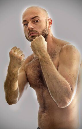 hairy male: Fighter rough male in a fighting position.