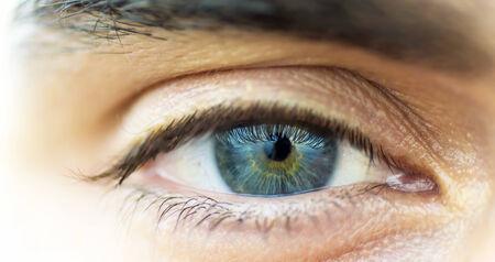 Macro closeup of a blue human eye.